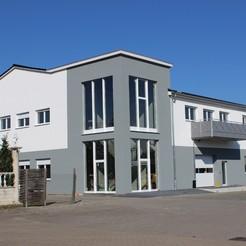 Postverteilungszentrum und Geschäftsräume im OG
