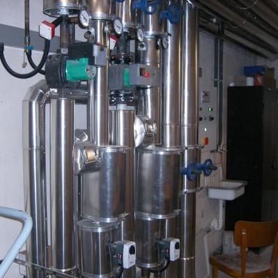 Uni Hamburg: Wärmedämmung der Heizungsanlage mit Mineralwollschalen und Blechmantel