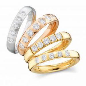 Trauringe in in verschiedenen Edelmetallen und  mit Diamanten besetzt